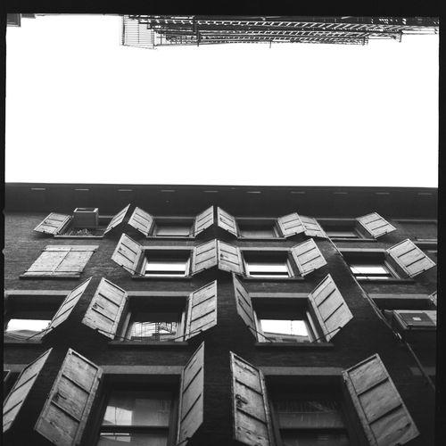 New York City shutters Bnw_friday_eyeemchallenge Kodak Tri-X 400 EyeEm Best Shots - Black + White EyeEm Bnw Bnw_collection Film Photography Hasselblad Hasselblad500c Street Photography New York Blackandwhite Streetphotography Streetphoto_bw Medium Format EyeEm Masterclass EyeEmNewHere EyeEm Bnw EyeEm Gallery EyeEm Selects EyeEmBestPics EyeEm Diversity EyeEm Best Shots - Black + White EyeEm Best Shots - Black + White Architecture Built Structure Sky Building Exterior Transfer Print Clear Sky Low Angle View
