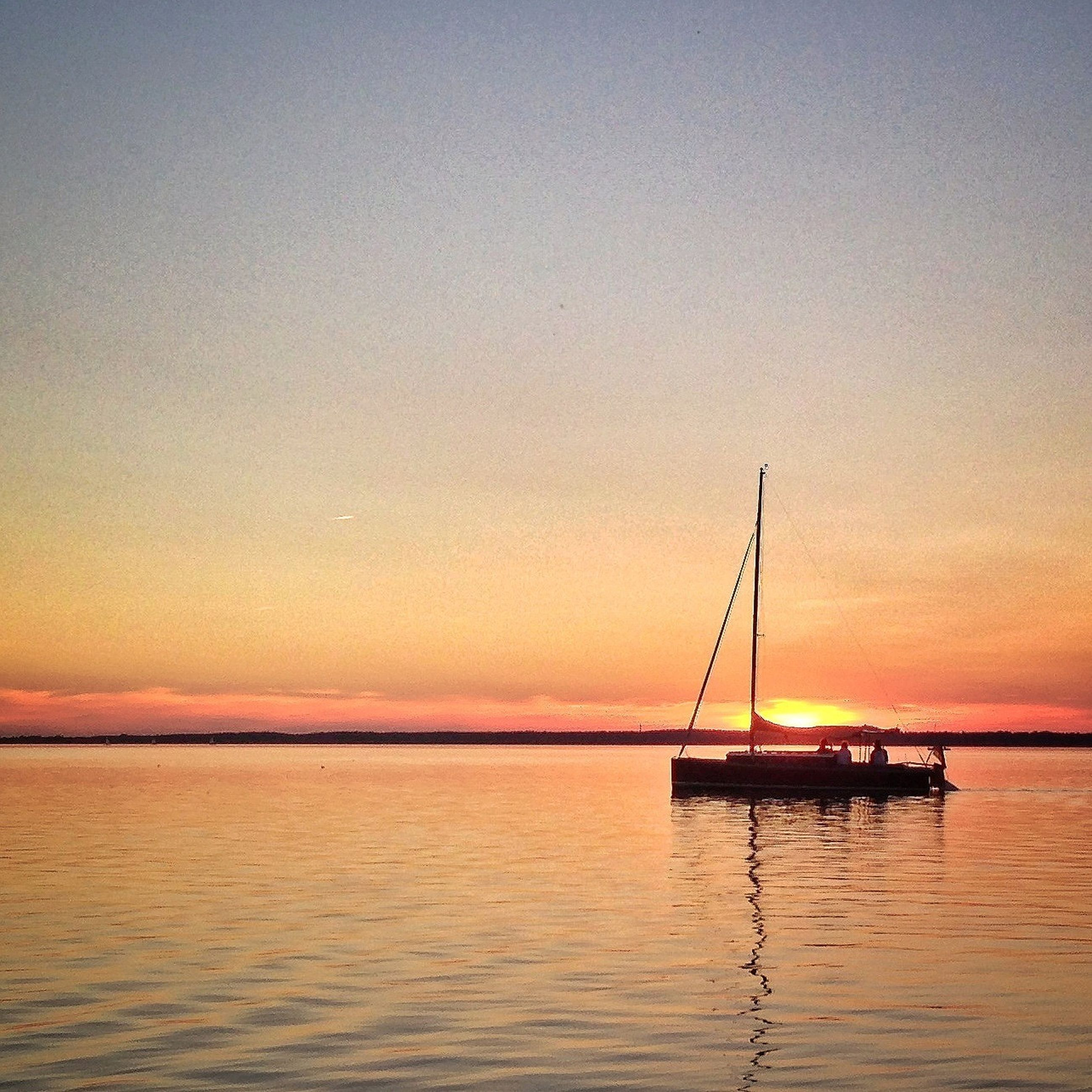 transportation, sunset, nautical vessel, water, mode of transport, boat, sea, waterfront, orange color, tranquil scene, tranquility, sailing, beauty in nature, scenics, sky, nature, silhouette, copy space, sailboat, horizon over water