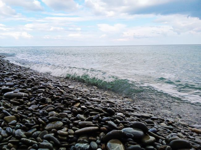 this is actually not the typical sand you might find in a beach EyeEmNewHere Pebble Beach Water Wave Sea Beach Sand Pebble Low Tide Horizon Water's Edge