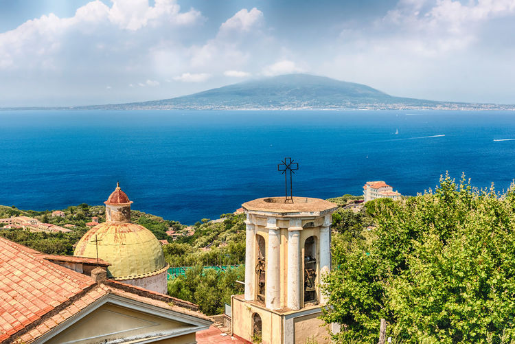 Aerial view of the Mount Vesuvius from Sorrento, Bay of Naples, Italy Architecture Beauty In Nature Blue Building Exterior Built Structure Cloud - Sky Day High Angle View Horizon Over Water Mountain Nature No People Outdoors Roof Scenics Sea Sky Tranquil Scene Tranquility Tree Water