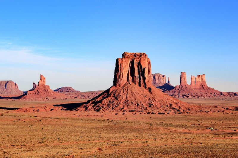 Scenic View Of Monument Valley Against Blue Sky
