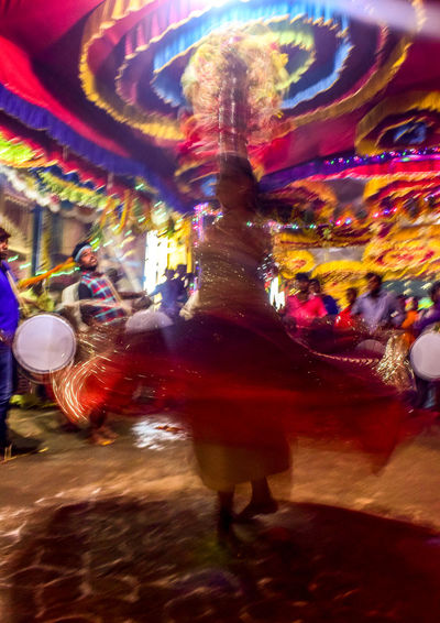Motion capture Multi Colored Arts Culture And Entertainment Streetphotography Social Event  Music Indian Street Photography Cultures Night Art Is Everywhere Dance Tredition Karnataka Tradition Karnatakaisbeautiful Travelphotography Treditional Culture Treditional Dance Dance Photography Traditional Culture Travel India Indianphotography Karnatakadiaries
