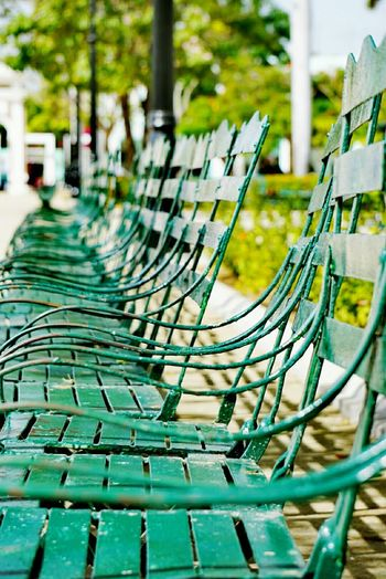 Close-up of empty chairs in row