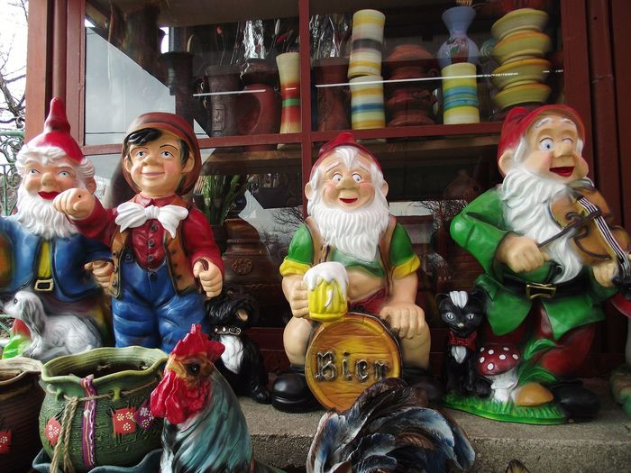 View of statues for sale at market stall