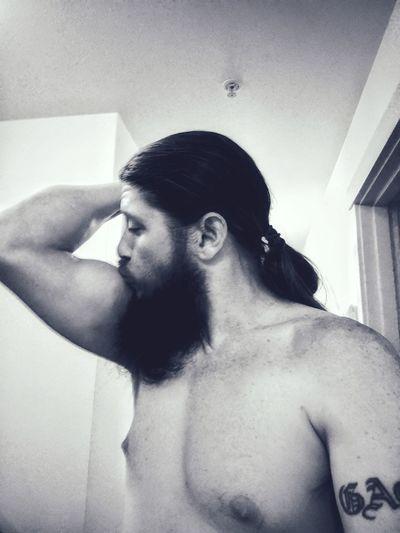 Close-up of shirtless man at home