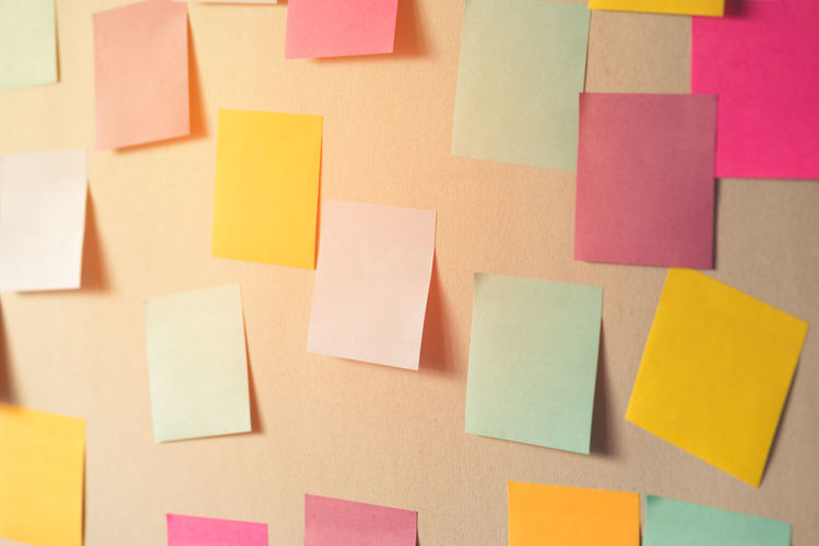 Blank Colorful Adhesive Notes On Bulletin Board