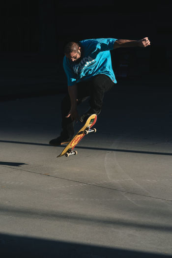 Young man jumping on skateboard