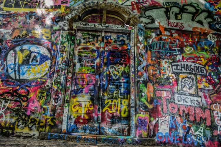 Architecture Art And Craft Built Structure Choice Communication Creativity Day Graffiti Messy Multi Colored Mural No People Outdoors Pattern Representation Street Art Text Variation Wall - Building Feature Western Script