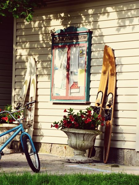 Caretaker's Cottage. Cottage Lake Life Nikon Shadows Sunny Day Family Vacation Homey Vintage Style Old Wooden Ski Bicycle Building Exterior Architecture Built Structure House Flower No People EyeEmNewHere Outdoors Day Nature Window Box