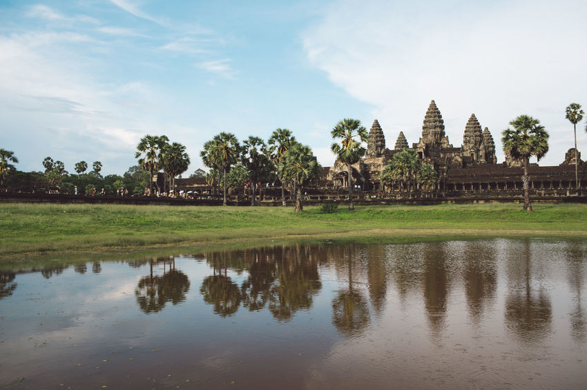 Siem Reap Cambodia Angkor Angkor Wat Angkor Wat, Cambodia Water Sky Reflection Built Structure Architecture Plant Waterfront Tree Nature Religion Lake Building Building Exterior Place Of Worship History Belief Travel Destinations The Past Tranquility No People Outdoors