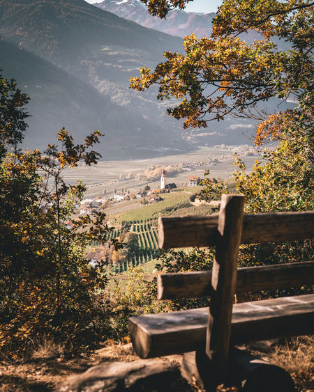 Nature Tree Plant Mountain Architecture Seat Outdoors Environment Landscape Sunlight No People Barrier Boundary Built Structure Positive Emotion Empty Bench Fence Rustic Park Bench Hiking Bench Relaxing Panorama Meran