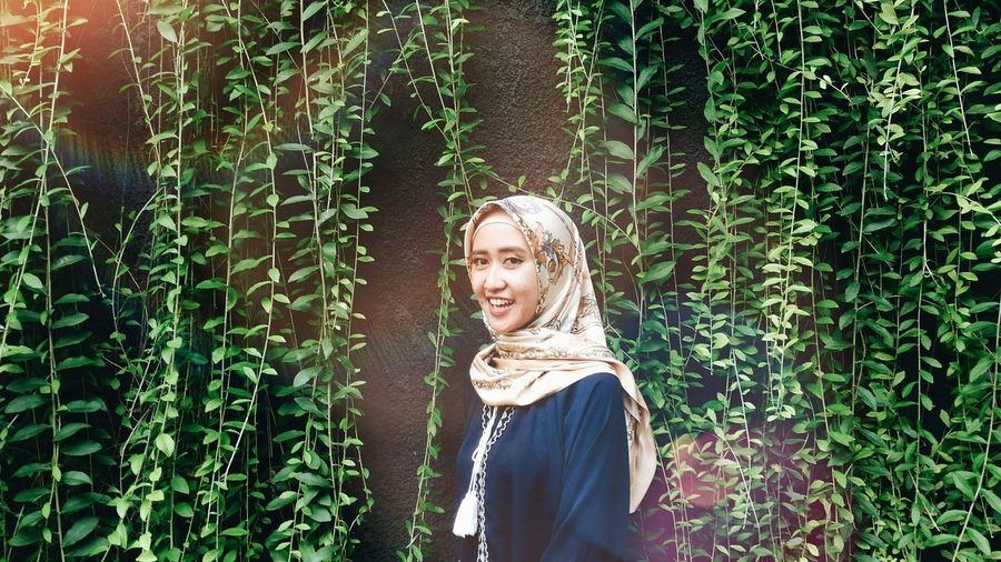 EyeEm Nature Lover EyeEmNewHere #youngadult #indonesia_photography Only Women One Woman Only Adults Only One Young Woman Only Day Adult Blond Hair Beautiful Woman Young Women Plant Outdoors Smiling Nature Young Adult EyeEm Ready