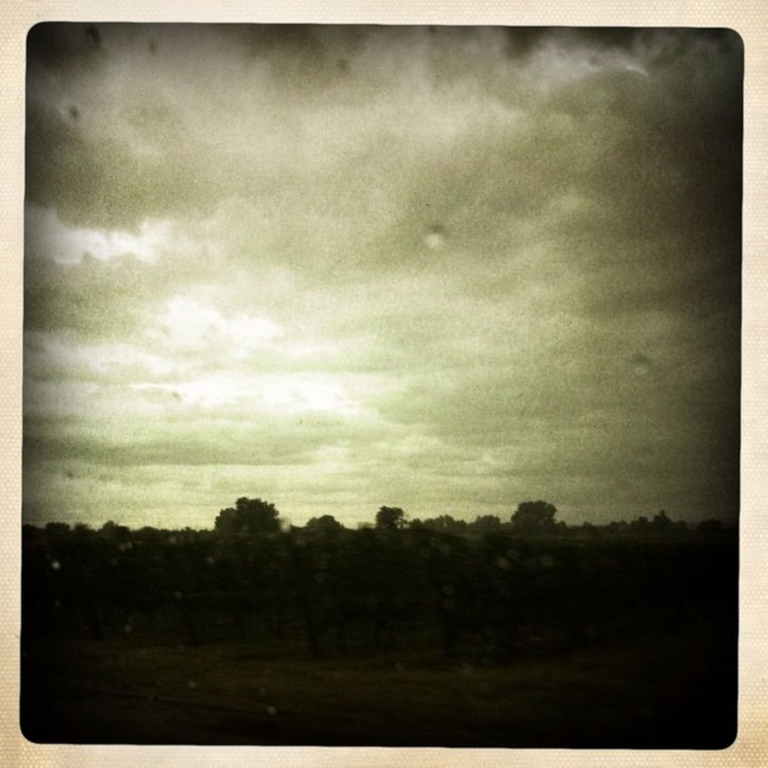 transfer print, sky, auto post production filter, cloud - sky, cloudy, tree, tranquil scene, tranquility, scenics, weather, beauty in nature, landscape, overcast, nature, field, cloud, dusk, outdoors, no people, silhouette