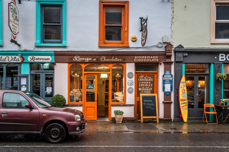 Scenic view of the town of Kenmare in the Wild Atlantic Way of Ireland Ireland Kenmare Shopping Travel Wild Atlantic Way Architecture Building Exterior Built Structure Cafe City Commercial Illuminated Irish Outdoors Restaurant Ring Of Kerry Store Storefront Street Town Travel Destinations Village