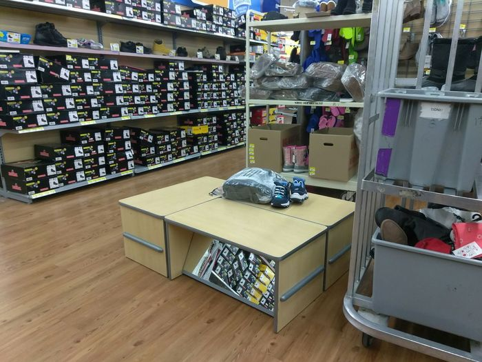 Indoors  Large Group Of Objects Retail  Shelf Abundance Shoes