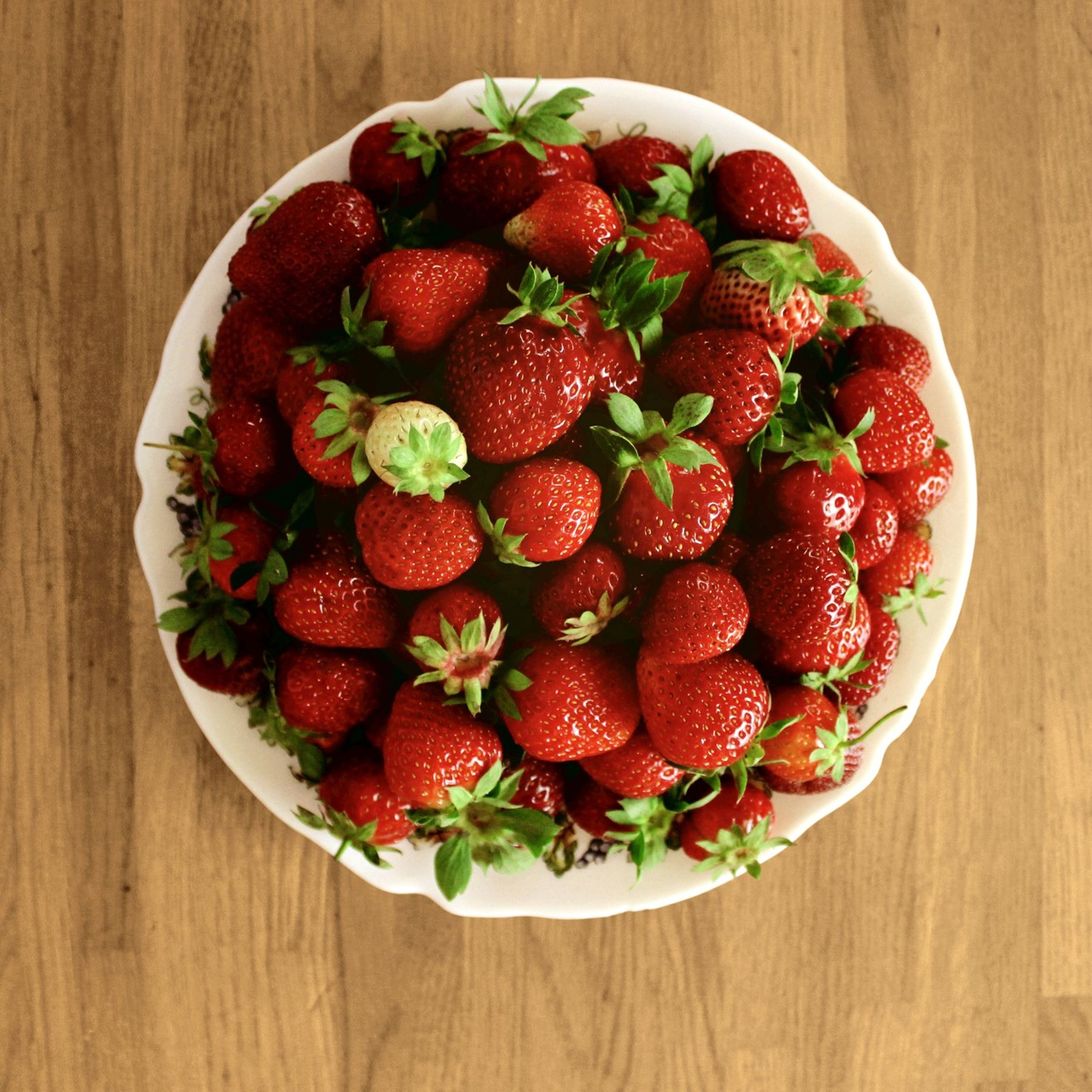 food and drink, food, freshness, indoors, fruit, healthy eating, table, still life, directly above, high angle view, strawberry, red, wood - material, ready-to-eat, bowl, plate, raspberry, ripe, juicy, close-up