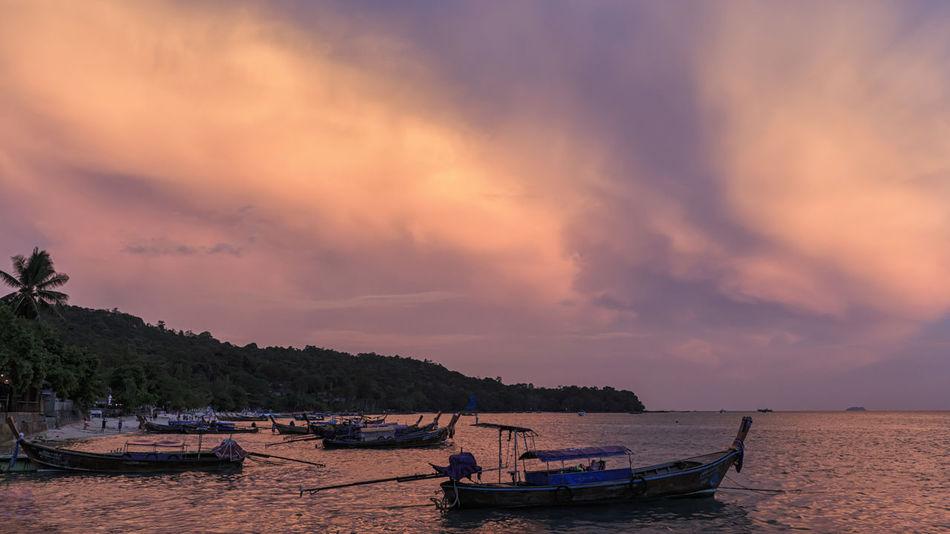 Sunset over Phi Phi Don Island in Krabi, Thailand Ao Nang Infinity Pool Krabi Luxury Hotel Maya Bay Railay Thailand Beach Losama Bay Palm Trees Paradise Phi Phi Island Resort Summer Water