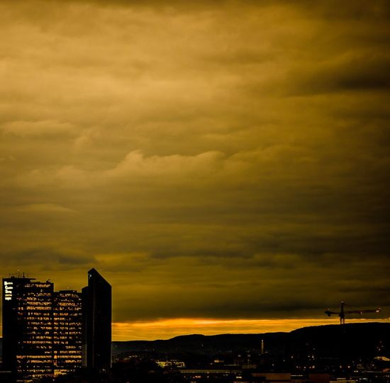 Dramatic sky over city during sunset