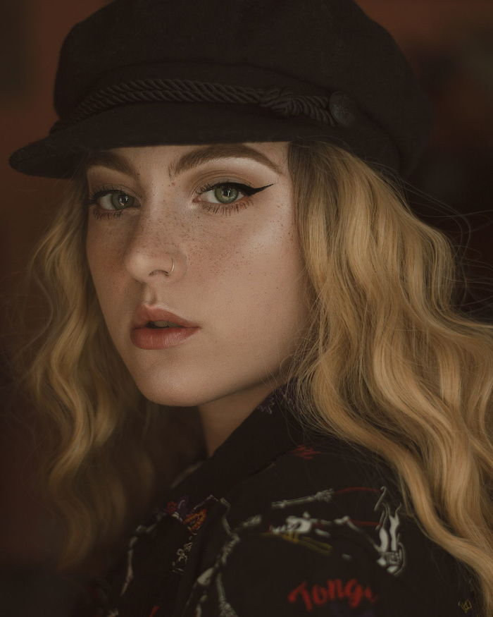 Close-up portrait of beautiful young model wearing cap