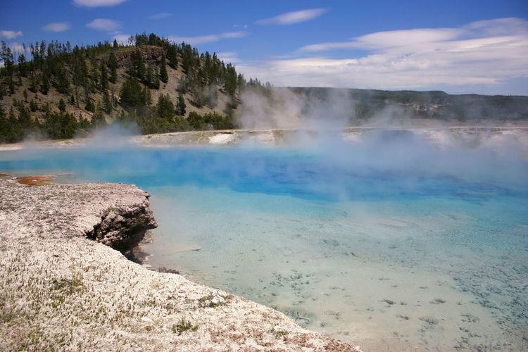 Blue turquoise geyser pond, yellowstone, wyoming, usa