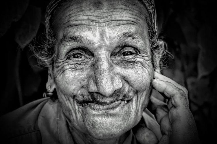 Close-up portrait of smiling senior woman