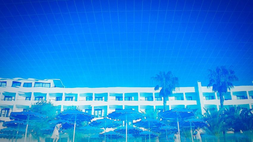 Hotel Mirrored In The Pool Hotel Swimming Pool Sunbeds Umbrellas Sun Umbrellas Holidays Distrortion Reflection Romantic Impression Impressionism light and reflection Enjoy The New Normal