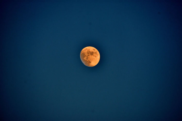 View of moon against blue sky