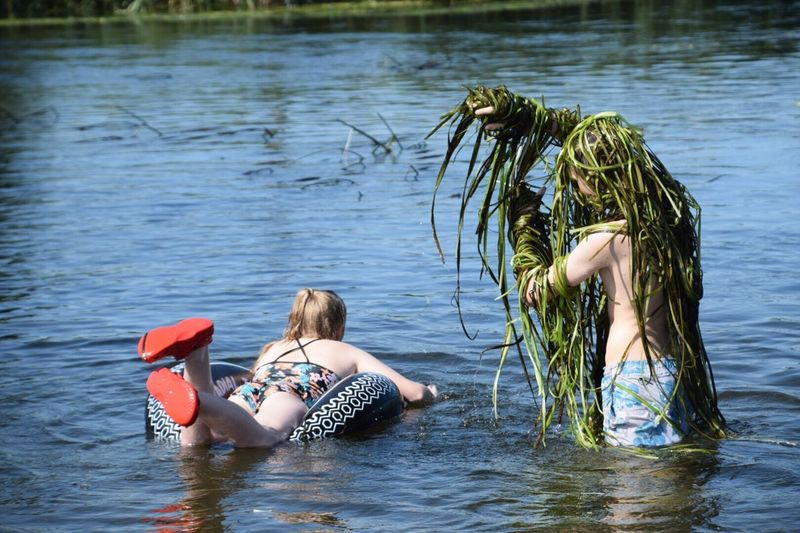 Two People Togetherness Rear View Water Leisure Activity Summer Day Vacations People Child Adult Girls River Scaring Your Sibling River Reeds Swamp Monster River Swimming River Fun Holidays Outdoors Blond Hair Bonding Sitting Childhood Adventure