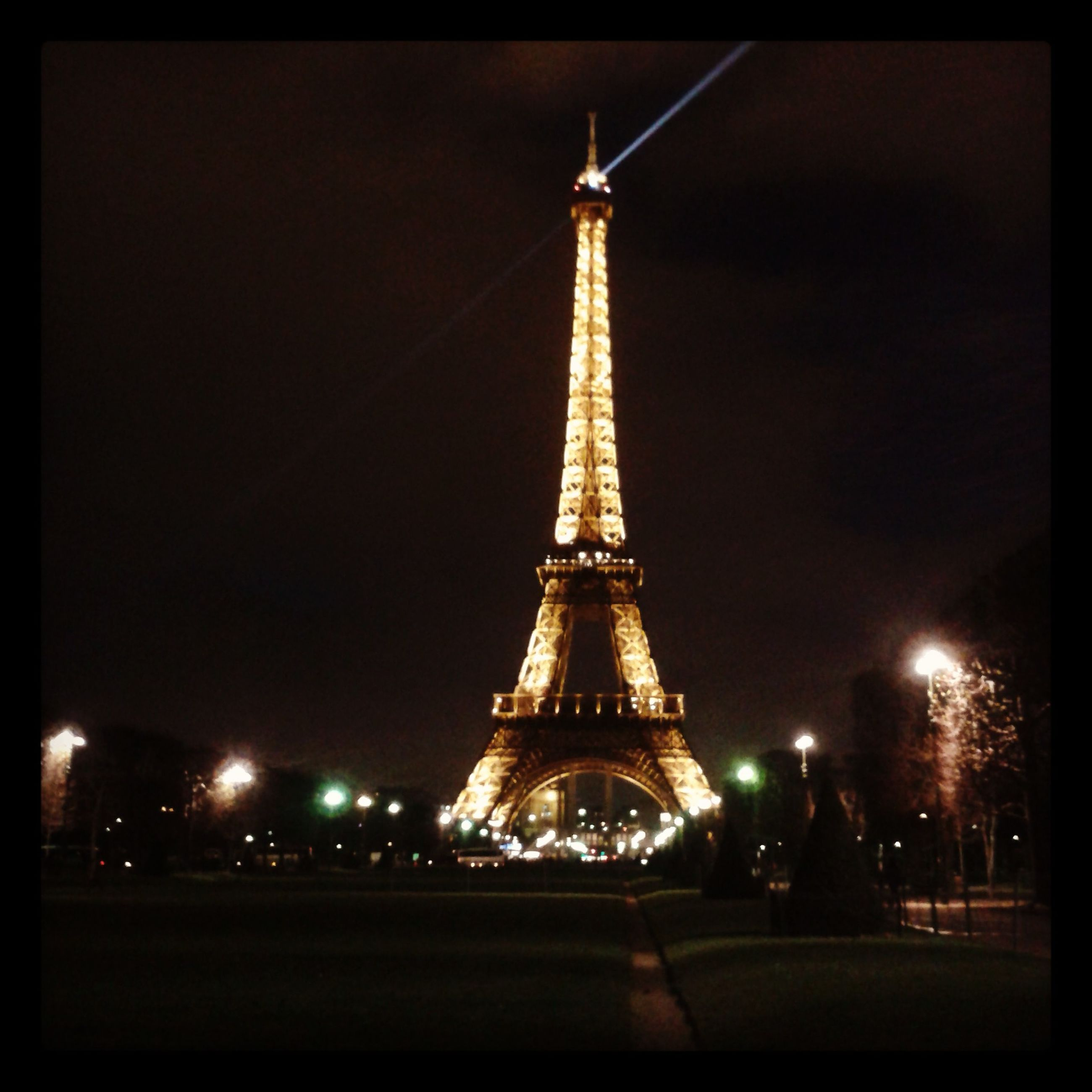 illuminated, night, transfer print, eiffel tower, architecture, built structure, travel destinations, famous place, international landmark, sky, capital cities, tourism, travel, tower, tall - high, auto post production filter, city, dusk, metal, low angle view