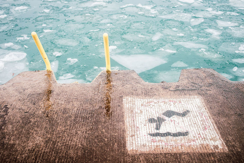 High angle view of text written on swimming pool
