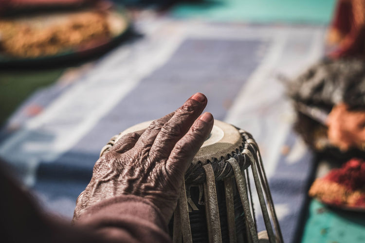 Specifically in this puja ceremony the asistants were playing music during hours with diferent kinds of nepali music instruments. Hand Selective Focus Human Hand Lifestyles Human Body Part Leisure Activity Body Part Musical Instrument Music Documentary Photography Documentaryphotography Nepal Travel Nepal Kathmandu Kathmandu, Nepal Ceremony Sacred Travel Destinations Travel Culture And Tradition Puja Celebration Real People Close-up Drums Musical Equipment
