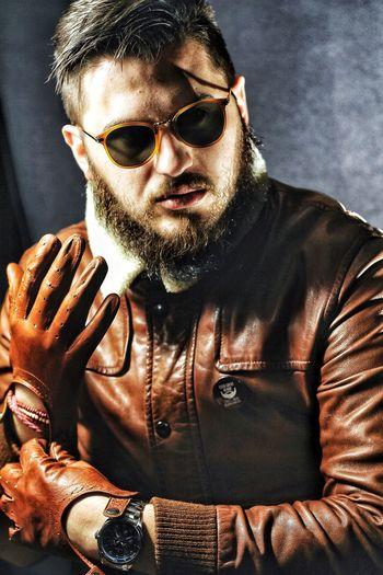 Portrait Of Man In Leather Jacket Wearing Gloves