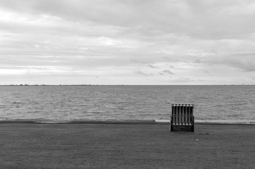 Loneliness Schleswig-Holstein Strandkorb Beach Beach Chairs Beachphotography Beauty In Nature Blackandwhite Blackandwhite Photography Cloud - Sky Day Horizon Over Water Nature No People North Sea Outdoors Sand Scenics Sea Sky Tranquil Scene Tranquility Water
