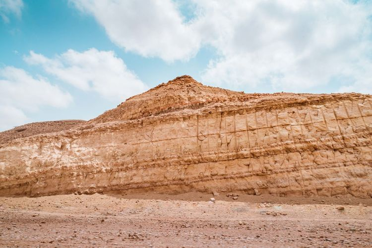 Oman Chapters Sky Cloud - Sky Land Scenics - Nature Tranquil Scene Environment Nature Rock Formation Day Desert Rock Mountain Tranquility Non-urban Scene Geology Beauty In Nature Rock - Object Landscape No People Physical Geography Climate Arid Climate Outdoors Formation Semi-arid