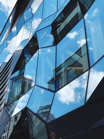 Facade Building Exterior Built Structure Architecture Low Angle View Building Reflection Glass - Material Cloud - Sky Sky Modern City Tall - High Skyscraper Office Building Exterior Office