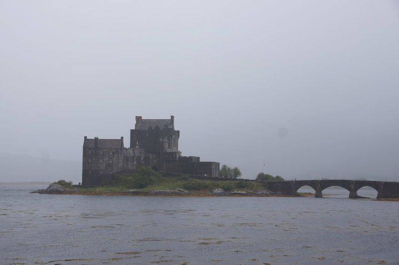 Eilean Donan Castle on a foggy summer's morning with the tide rolled in. Castle Loch  Scotland Arch Bridge Architecture Bridge Bridge - Man Made Structure Building Building Exterior Built Structure Castle Connection Eilean Donan Castle History Lake No People Scottish Castle Scottish Highlands The Past Water Waterfront