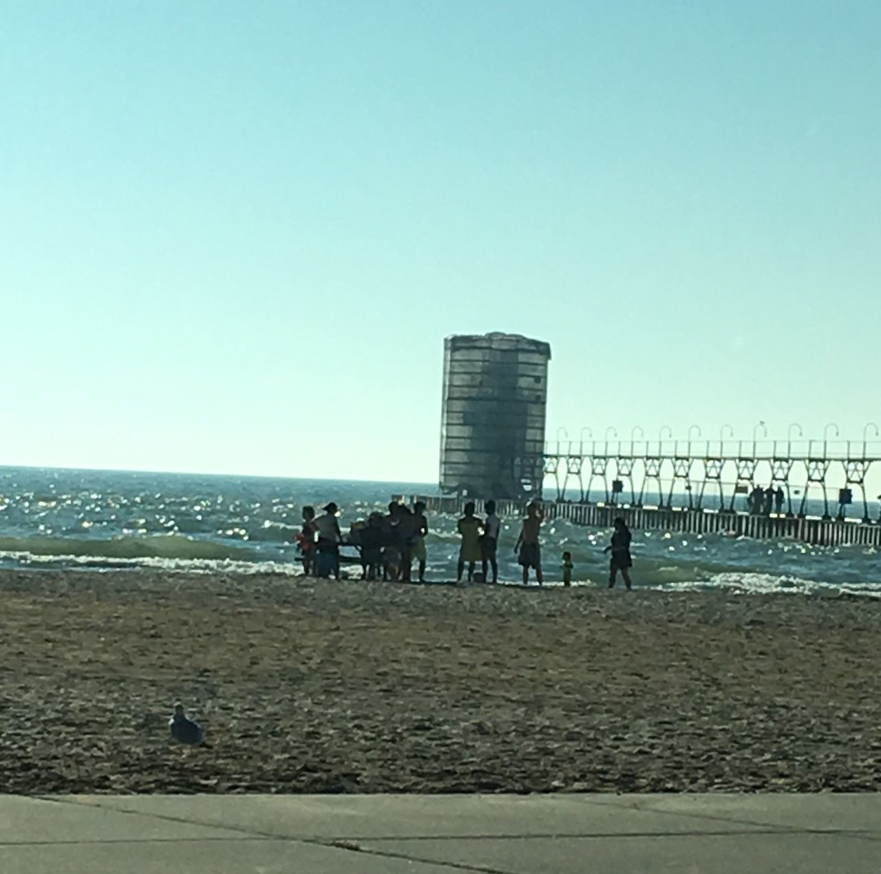 beach, real people, sea, sand, water, leisure activity, day, large group of people, outdoors, clear sky, nature, vacations, lifestyles, sky, architecture, men, built structure, travel destinations, horizon over water, building exterior, people, adult