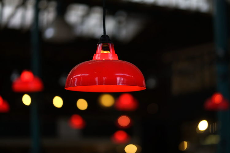 Markthalle Neun Markthalle Neun Red Illuminated Hanging Lighting Equipment Night No People Close-up Focus On Foreground Light City Architecture Built Structure Outdoors Selective Focus Decoration Window Retail  Electric Lamp