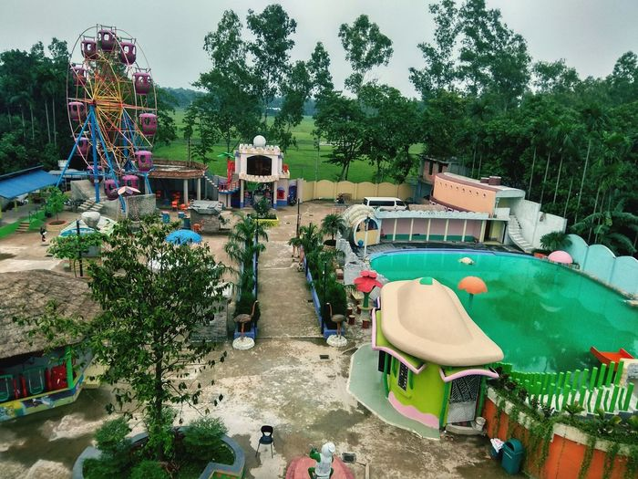 park Green Color Tree Water Swimming Pool Sky Water Park Water Slide Slide Outdoor Play Equipment Jungle Gym Amusement Park Ride Slide - Play Equipment