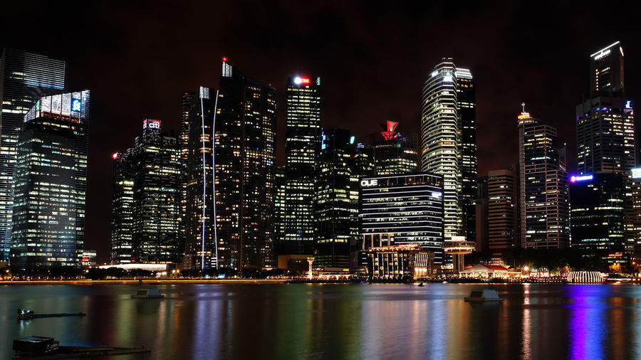 Landscape of the bay front in the scene of commercial buildings Cityscape Marina Bay Singapore Singapore Architecture Bay Front Building Exterior Built Structure City Cityscape Destination Hotel Illuminated Landscape Modern Night No People Outdoors Sky Skyscraper Travel Destinations Urban Skyline Water Waterfront