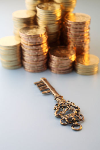 large group of object golden coins Antique Circle Currency Shinny Stack Bank Cash Close-up Coins Finance Gold Coin Golden Hour Investment Key Key Of Success Large Group Of Objects Lock Money No People Savings Stack Still Life Studio Shot Tax Return Wealth