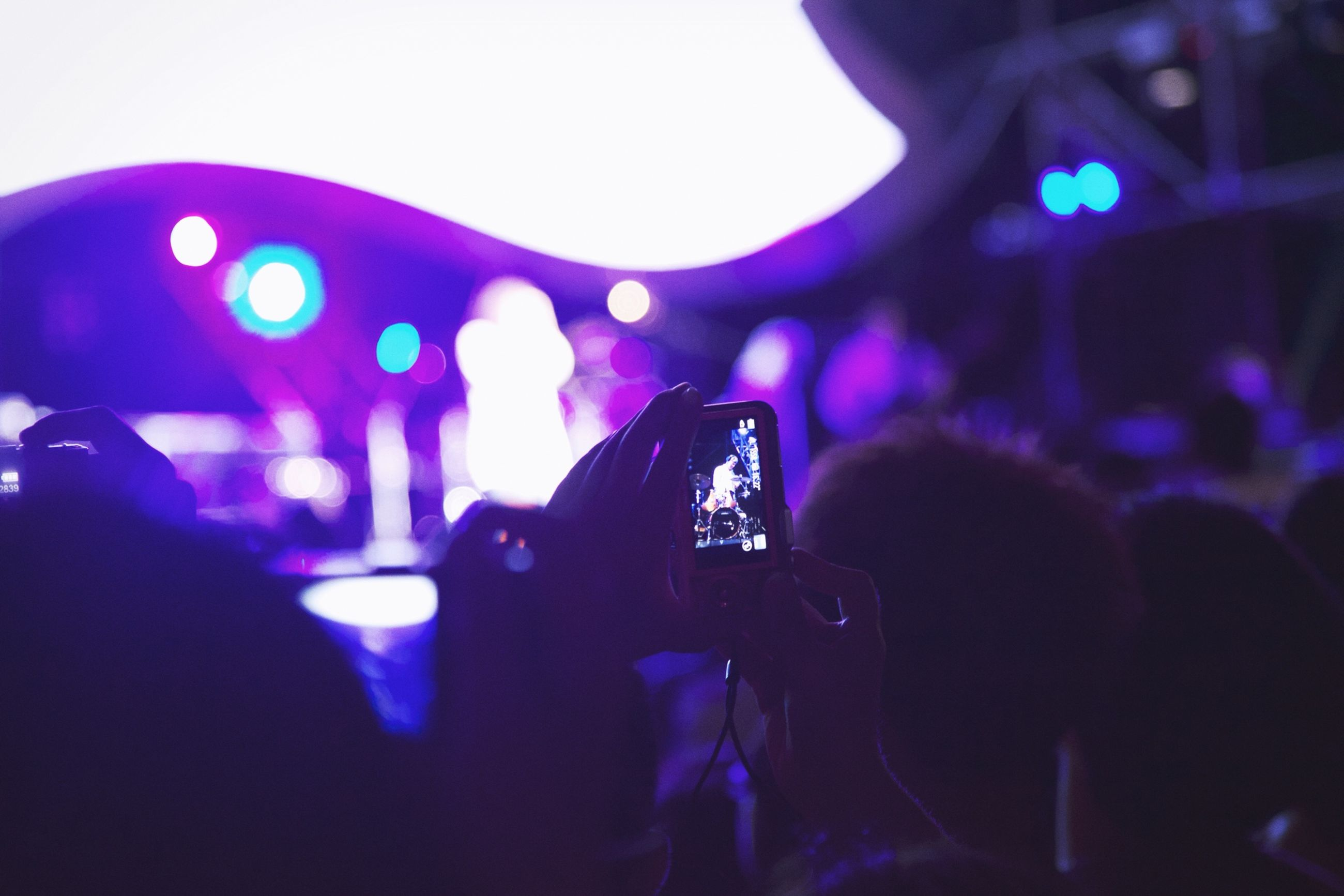 illuminated, arts culture and entertainment, indoors, music, nightlife, leisure activity, lifestyles, large group of people, men, enjoyment, performance, crowd, night, youth culture, fun, light - natural phenomenon, nightclub, person, stage - performance space