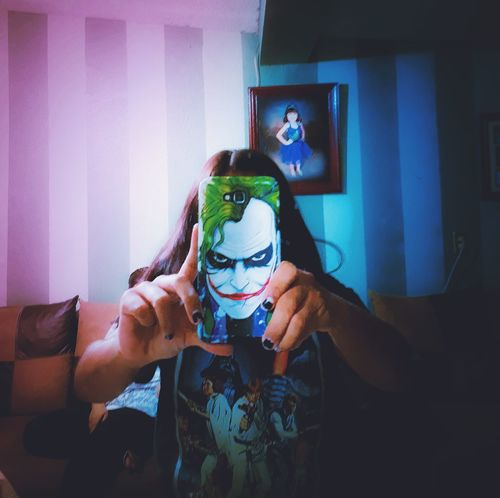 Joker Adults Only Leisure Activity Photographing Two People Adult Photography Themes Mid Adult People Technology Only Women Underwater Holding Indoors  Men Young Adult Young Women Redandblue Camera - Photographic Equipment Photographer Headshot Vacations