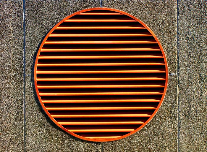 City Orange Abstract Air Conditioner Air Duct Architecture Backgrounds Built Structure Cast Iron Circle Close-up Day Metal Metal Grate Minimal No People Outdoors Pattern Sewage The Graphic City