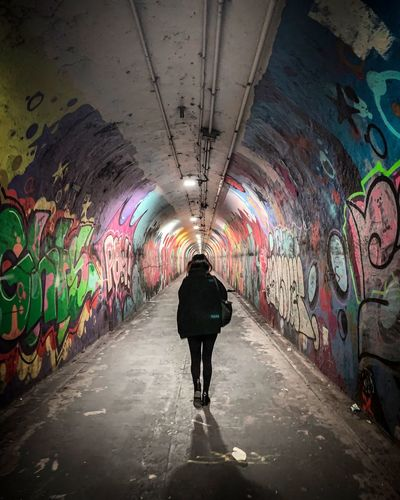NYC LIFE ♥ Graffiti Art Graffiti Architecture Tunnel Multi Colored Rear View Full Length Indoors  Street Art Transportation Wall - Building Feature Ceiling Standing Built Structure One Person The Way Forward Direction