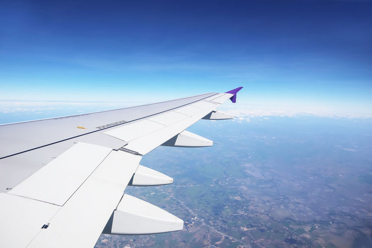 Airplane Air Vehicle Aircraft Wing Transportation Mode Of Transportation Flying Sky Travel No People Nature Mid-air Blue Beauty In Nature Journey Aerial View Motion Environment Day Cloud - Sky Scenics - Nature Outdoors