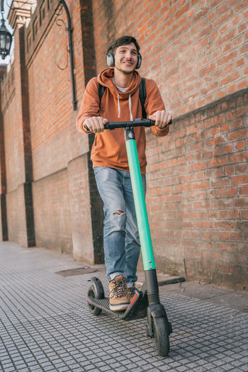 Smiling man on push scooter