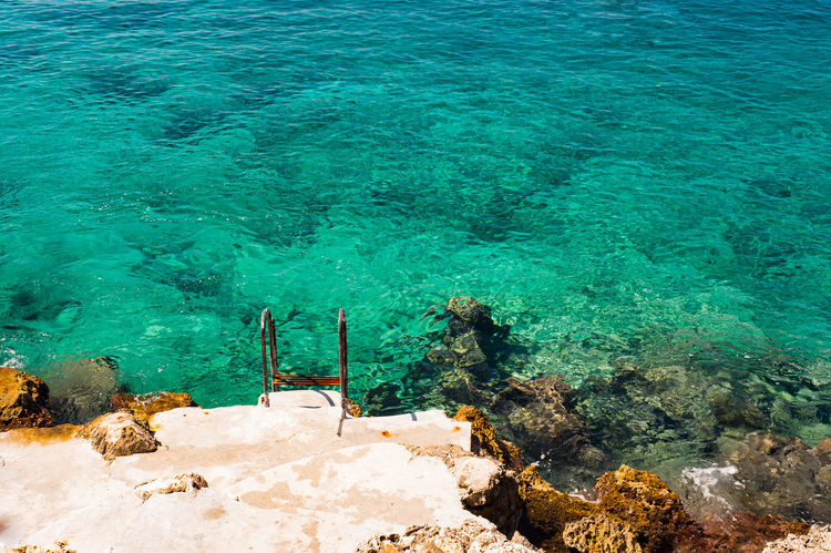 Turquoise Sea and Rocks Empty Space Holiday Kas Serenity Tranquility Turquoise Colored Vacation Time Vacations Beauty In Nature Day Empty High Angle View Nature No People Outdoors Scenics Sea Seascape Seaside Summer Tranquil Scene Turquoise Vibrant Vibrant Color Water The Week On EyeEm