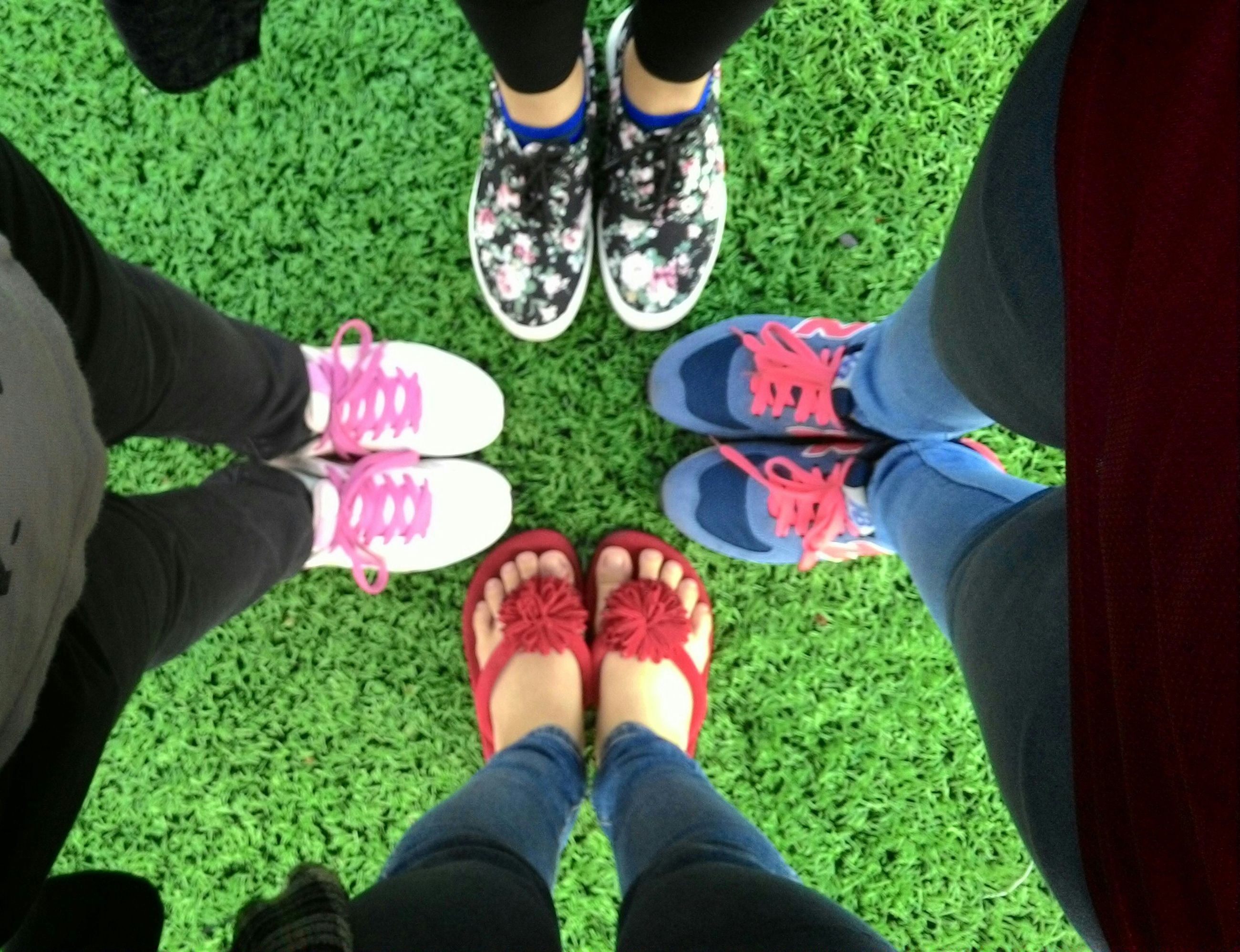 low section, person, shoe, lifestyles, men, grass, leisure activity, togetherness, standing, human foot, personal perspective, field, footwear, jeans, friendship, bonding