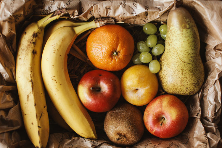Directly above view of fresh fruits in paper bag